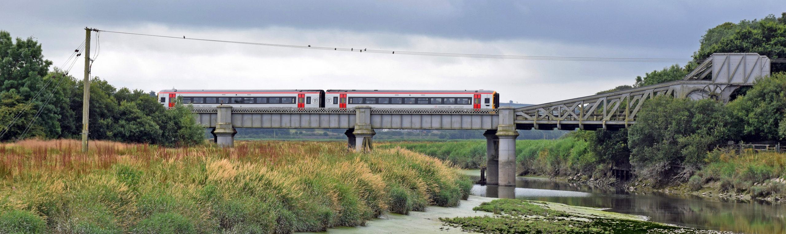 TFW train crossing the river Tywi in Carmarthen